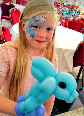 Matching Dolphin Face Painting and Balloon at Christening